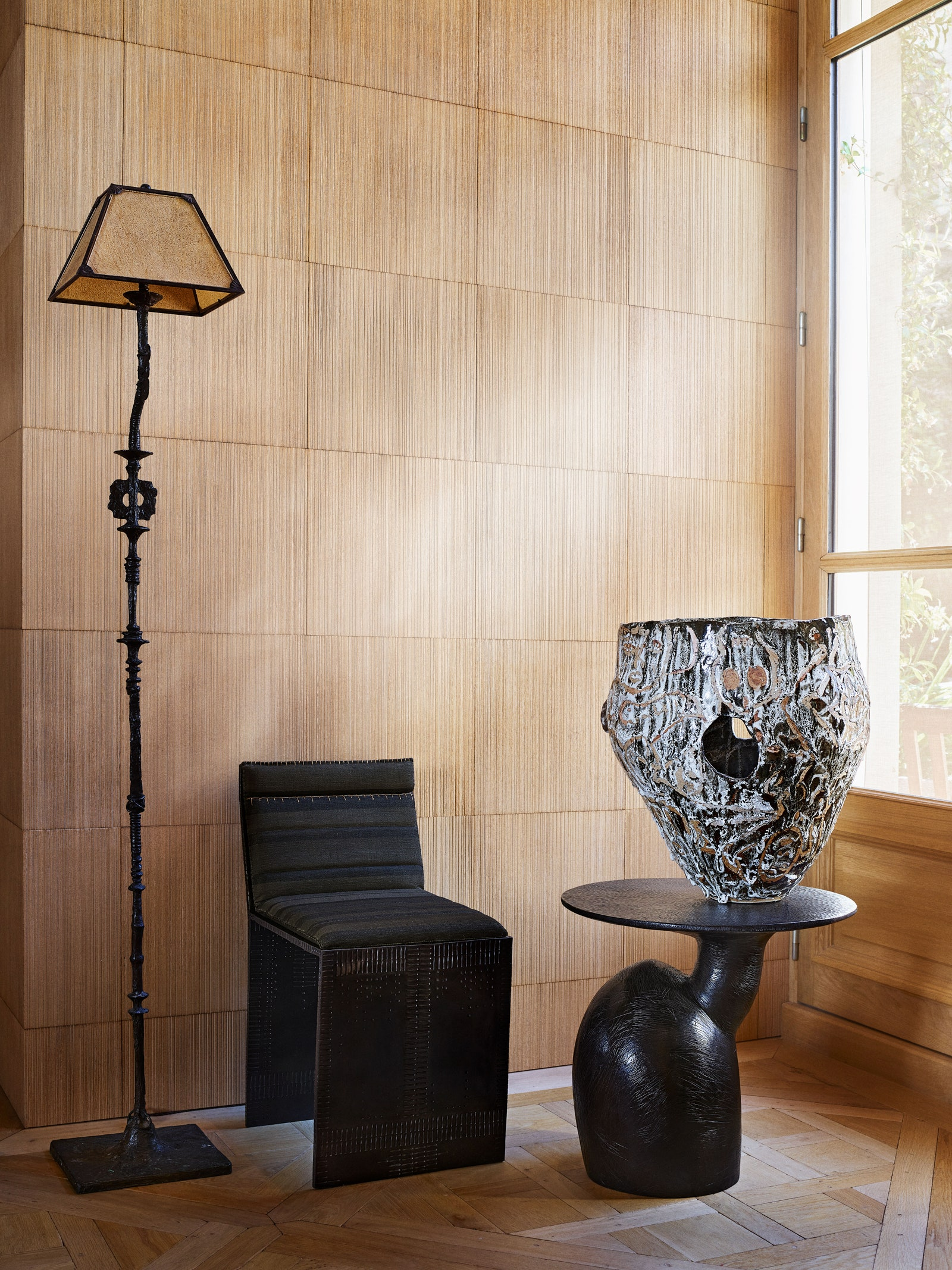 pA ceramic vessel by Roger Herman sits atop a table by Wendell Castle.p