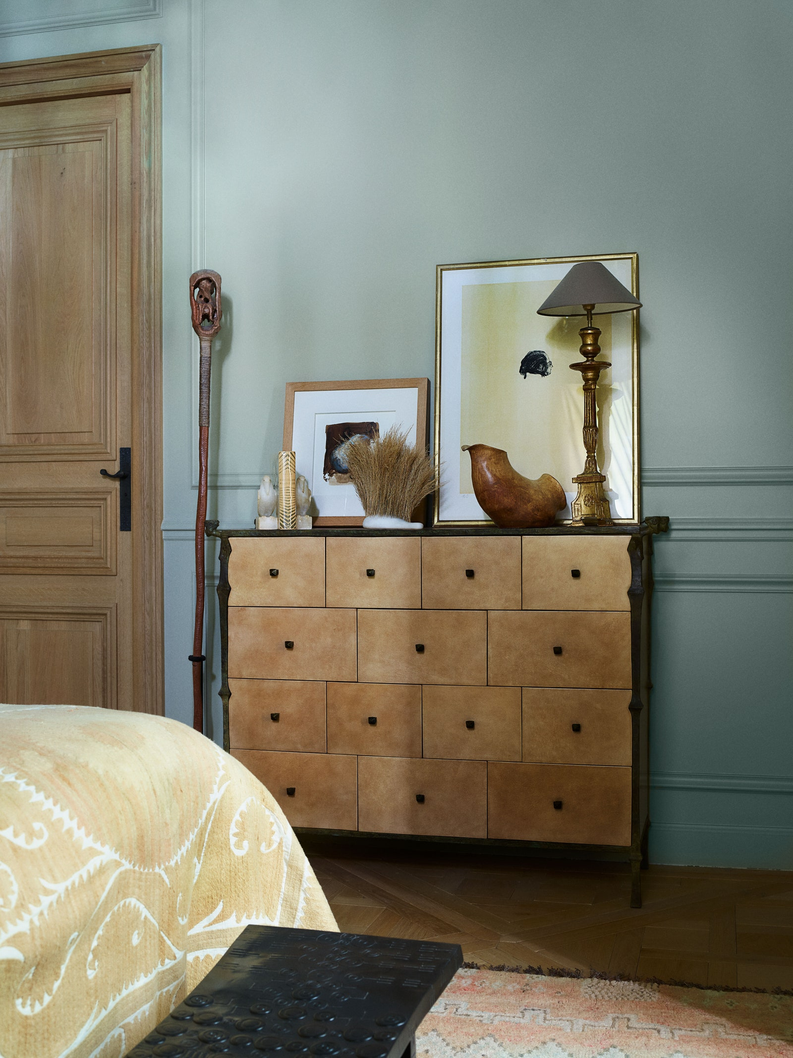pA chest by Donat stands in the bedroom.p