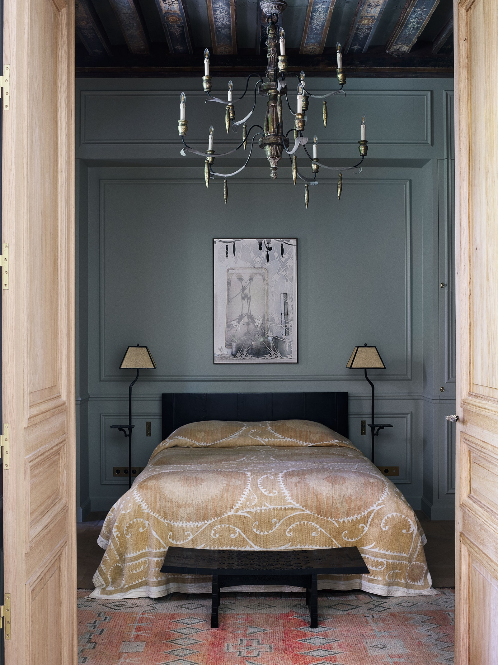 pThe Donatdesigned lacquer bed wears a textile from Uzbekistan. Donat also designed the bedside lamps and bench.p