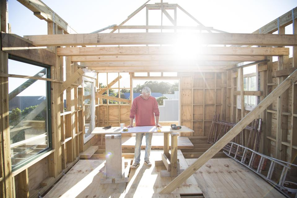 Builder working on a wood framed house