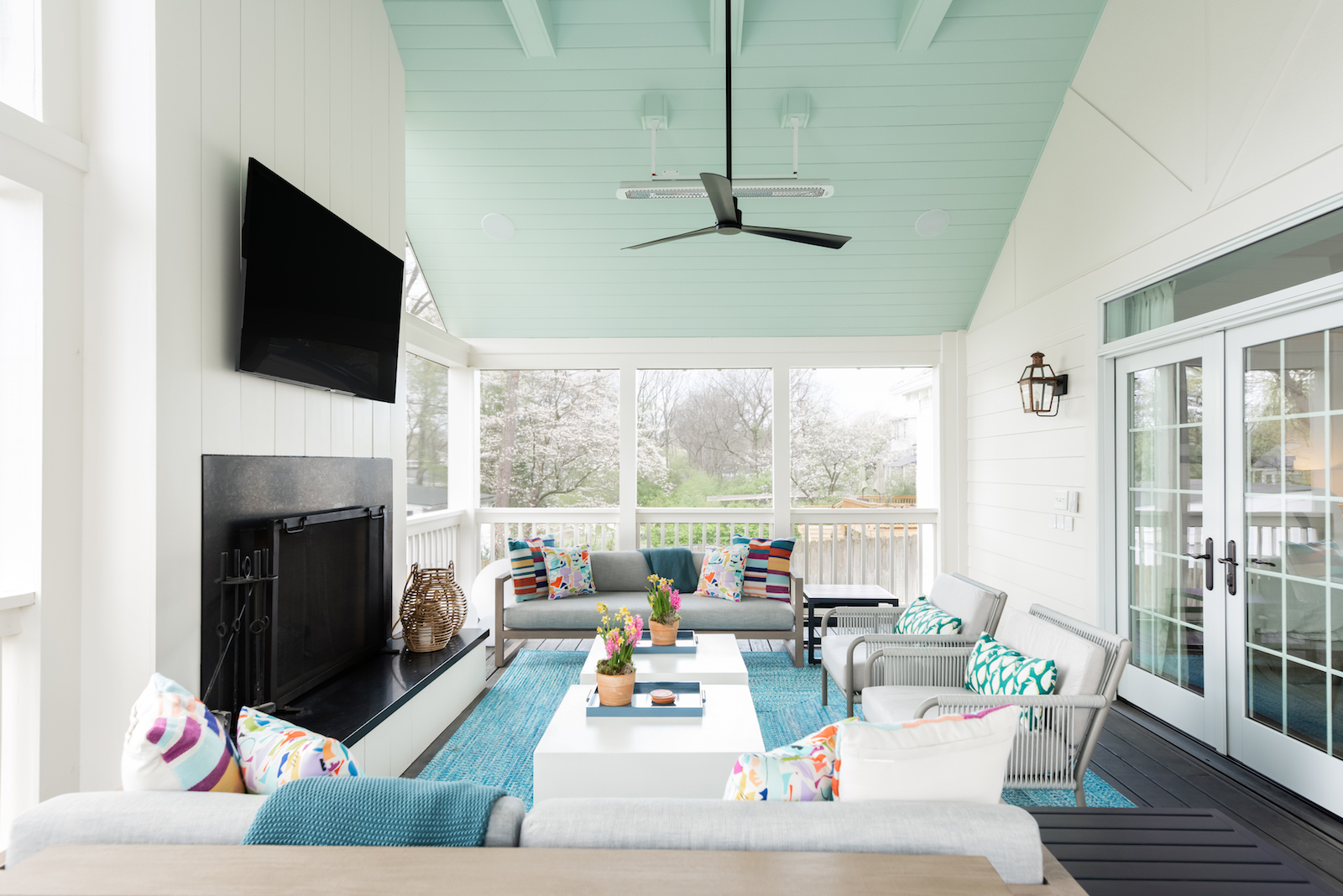 Screened porch with teal ceiling by Merrill Construction Group