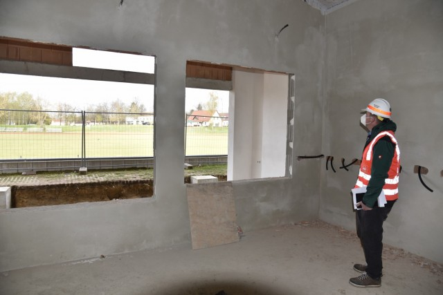 U.S. Army Corps of Engineers, Europe District Project Engineer Johann Buchfelder checks out ongoing construction of a new field house at Vilseck High School at Rose Barracks in U.S. Army Garrison Bavaria May 6, 2021. The new field house, adjacent to the school's athletics field, will not only serve as an area to store athletics equipment but is being designed as a focal point for social activities and events. The project is part of the Army's push for new and improved housing and other facilities to improve quality of life for Soldiers and their families stationed at Rose Barracks.