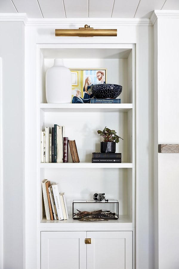 Trio of shelves with books and various collectibles