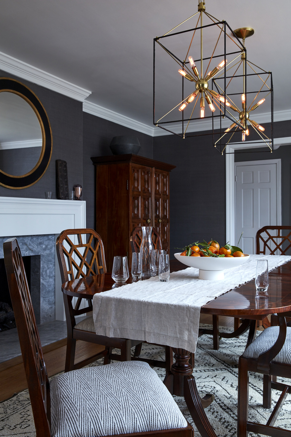 The dining room with newly recovered chairs and heirloom chest