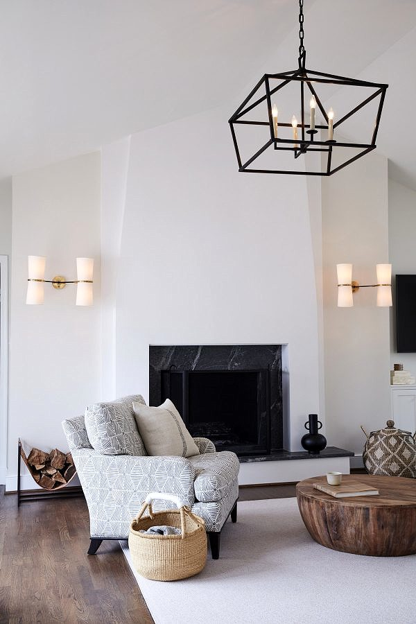 Family room with fireplace, neutral color scheme and circular wood table
