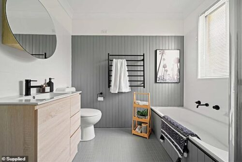 Renovation queen Cherie Barber transforms 70s bathroom into slick modern space for just $4,000